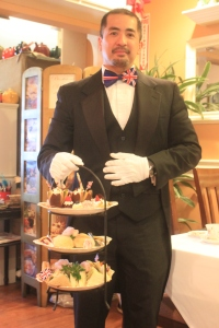 Peter the Butler brings our three-tier tray filled with delicious sandwiches, scones and sweeties!