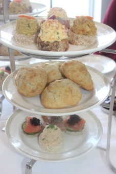 A delicious array of tea sandwiches and freshly baked scones!