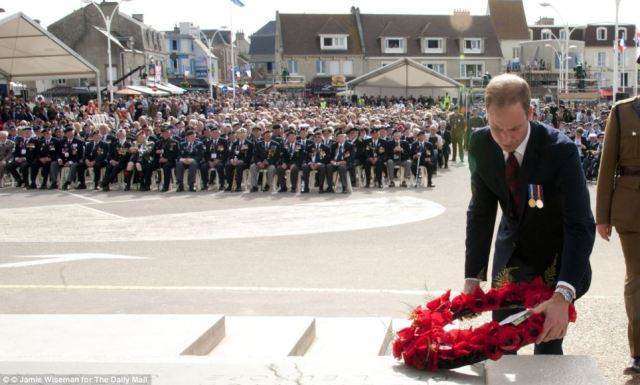 Prince William lays a wreath in honor of the fallen soldiers.