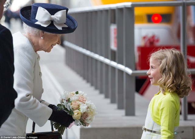 Lucky young girl presents The Queen with a floral bouquet ahead of her journey to Paris.