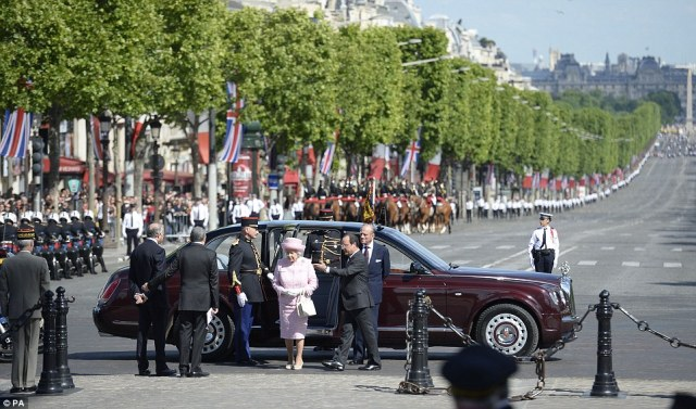 The streets of the Champs E'lysee were lined with well wishers as The Queen arrives the Arc de Triomphe and is greeted by the French President.