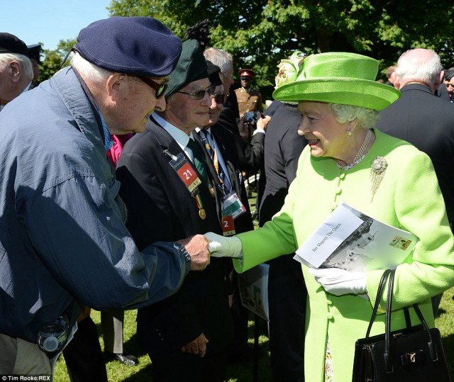 The Queen shakes the hand of a veteran who invaded the beachs of Normandy