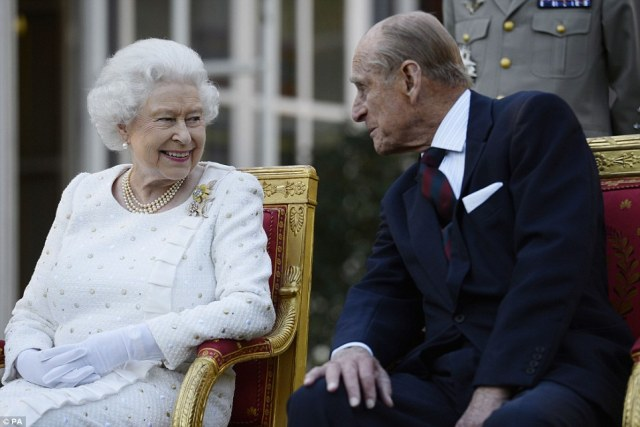 Prince Philip leans in to ask, 'Are we done yet?'