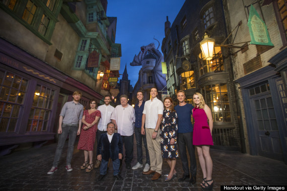 From left to right, the picture features: Bill Weasley (Domhnall Gleeson), Bellatrix LeStrange (Helena Bonham Carter), Neville Longbottom (Matthew Lewis), Professor Flitwick (Warwick Davis), Hagrid (Robbie Coltrane), the Weasley twins (Oliver and James Phelps), Ginny Weasley (Bonnie Wright), Draco Malfoy (Tom Felton) and Luna Lovegood (Evanna Lynch).