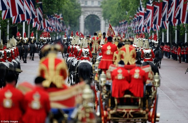 Thousands line The Mall, Union flags flying high as the monarch processed from Buckingham Palace to the Palace of Westminster in the Diamond Jubilee Coach.
