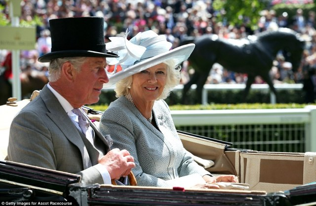 Prince Charles and The Duchess of Cornwall arrives in their carriage.