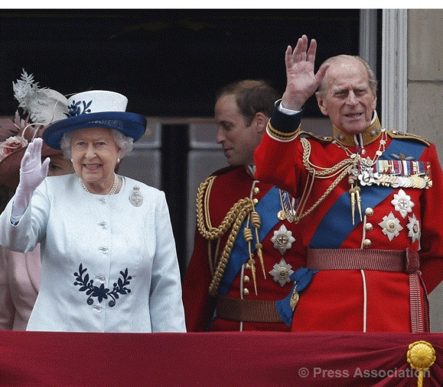 The Queen and The Duke of Edinburgh wave to the crowds from the balcony of Buckingham Palace following the Trooping the Colour parade, 14 June 2014.