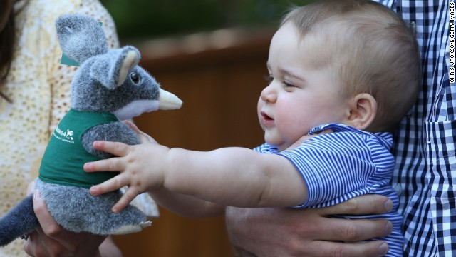 Baby George gets a toy bilby at the zoo.
