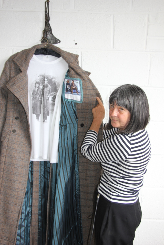Andrea displays the special hand-sewn patch that can be personalized for its recipient.