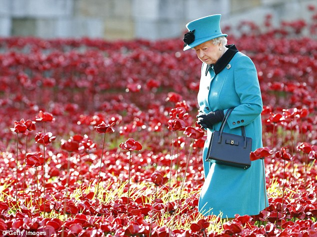 Stunned into silence, Her Majesty visits the Tower Poppies