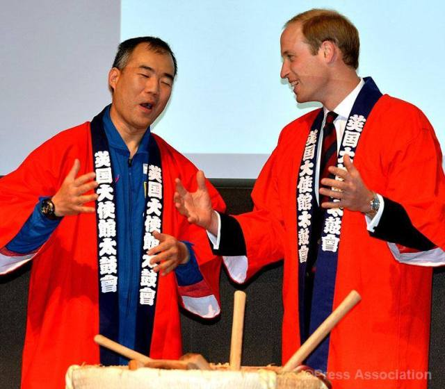 The Duke of Cambridge laughs with Astronaut Soichi Noguchi as he is clothed in a Japanese Happi coat before a Saki breaking barrel ritual. His Royal Highness was attending the Innovation is GREAT conference in Tokyo, promoting trade between the UK and Japan, 27 February 2015.