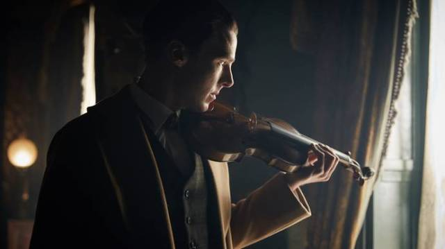 Beautiful picture of the Cumberbabe and his violin.