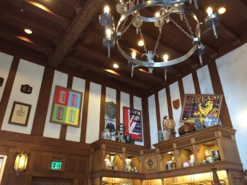 Timbered interior displaying an eclectic collection of British items.