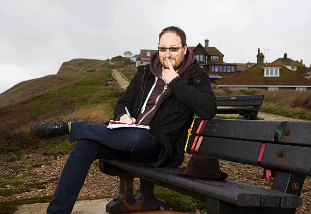 Chris Chibnall writing of the ITV program Broadchurch. on Bridgeport beach. Copyright photos by Les Wilson UK mobile 07966 155 905 Les@leswilson.com 17th Dec 2014